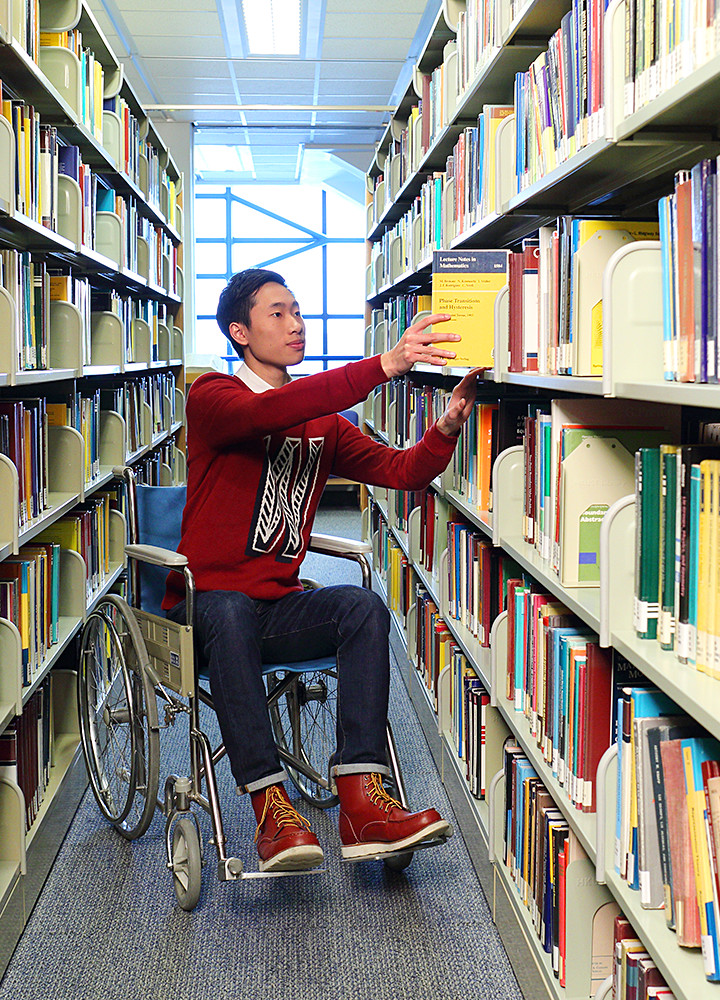 A wheelchair user in the library
